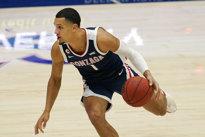 Gonzaga guard Jalen Suggs brings the ball up against Gonzaga during the first half of an NCAA basketball game in Moraga, Calif., Saturday, Jan. 16, 2021. (AP Photo/Jeff Chiu)