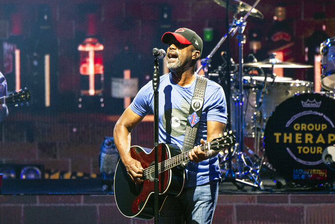 "FILE - In this July 20, 2019, file photo, Darius Rucker performs during the Group Therapy Tour at Riverbend Music Center in Cincinnati, Ohio. Rucker will perform a pre-race concert before the Daytona 500 in February.  It will be Rucker's fourth appearance at Daytona International Speedway and first at the ""Great American Race,"" which will again serve as NASCAR's Cup Series season opener. (Photo by Amy Harris/Invision/AP, File)"