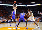 Tennessee guard Jordan Bowden (23) shoots over Florida guard KeVaughn Allen (5) during the first half of an NCAA college basketball game, Saturday, Feb. 9, 2019, in Knoxville, Tenn. (AP photo/Wade Payne)
