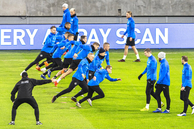 Iceland's players attend a training ahead of the the Euro 2020 playoff semifinal soccer match between Hungary and Iceland, in Puskas Arena in Budapest, Hungary, Wednesday, Nov. 11, 2020. Hungary and Iceland play each other on Thursday. (Zsolt Szigetvary/MTI via AP)