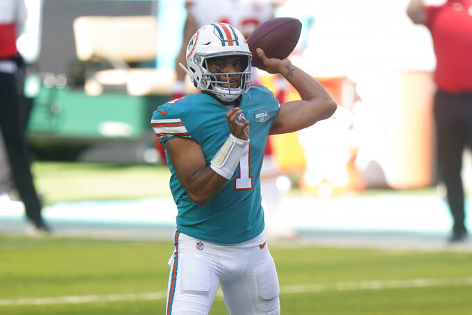 Miami Dolphins quarterback Tua Tagovailoa (1) looks to pass the football during the first half of an NFL football game against the Kansas City Chiefs, Sunday, Dec. 13, 2020, in Miami Gardens, Fla. (AP Photo/Wilfredo Lee)