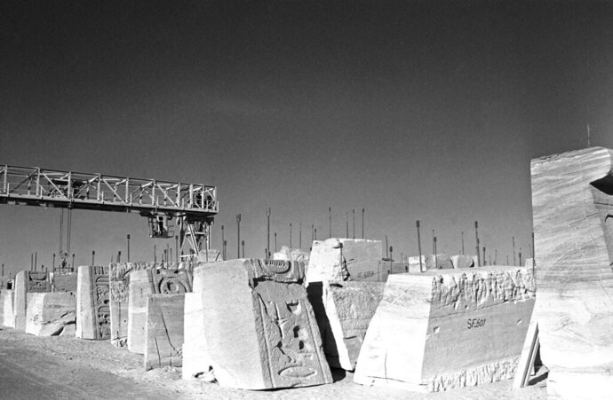 FILE - In this file photo taken on Feb. 8, 1966, the results of three-years of dismantling the temples of Abu Simbel in Egypt lie in a storage area behind the huge escarpment before being moved and re-assembled on higher ground. The global campaign that saved the ancient Egyptian temples of Abu Simbel from inundation by the Aswan Dam 50 years ago was remembered this week as an unprecedented engineering achievement and a turning point in the perception of cultural treasures as a responsibility of all humanity. (AP Photo)