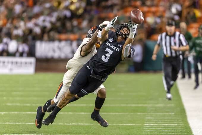 Hawaii wide receiver Jason-Matthew Sharsh (3) finds the pass just out of his reach while being defended by Oregon State defensive back Jaydon Grant (3) during the first half of an NCAA college football game, Saturday, Sept. 7, 2019, in Honolulu. (AP Photo/Eugene Tanner)