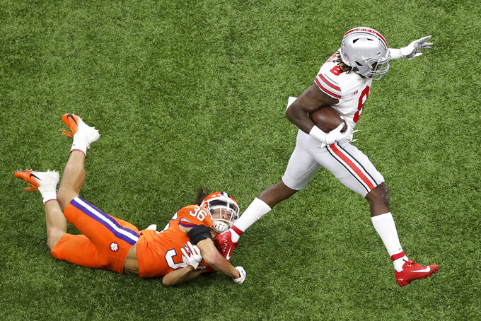 Ohio State running back Trey Sermon, right, breaks away from Clemson safety Lannden Zanders during a touchdown run in the first half of the Sugar Bowl NCAA college football game Friday, Jan. 1, 2021, in New Orleans. (AP Photo/Butch Dill)
