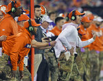 FILE - In this Nov. 17, 2018, file photo, Clemson defensive coach Brent Venables is pulled back by an assistant during the first half of an NCAA college football game in Clemson, S.C. Clemson's defense was a big reason why the Tigers won a second national championship in three seasons. Now that unit has massive holes to fill after losing its entire front to the NFL, along with three key linebackers and two members of the secondary _ and that could mean the Tigers have to win shootouts behind quarterback Trevor Lawrence to stay on top. (AP Photo/Richard Shiro, File)