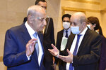 """In this photo released by the Lebanese Parliament media office, Lebanese French Foreign Minister Jean-Yves Le Drian, right, speaks with Lebanese Parliament Speaker Nabih Berri, in Beirut, Lebanon, Thursday, May 6, 2021. Le Drian began a visit to Lebanon Thursday with a message of """"great firmness"""" to its political leaders, threatening to take additional measures against officials obstructing the formation of a government in the crisis-hit country. (AP Photo/ Hassan Ibrahim, Lebanese Parliament media office)"""