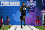 FILE - In this Feb. 27, 2020, file photo, Alabama wide receiver Henry Ruggs III runs the 40-yard dash at the NFL football scouting combine in Indianapolis. With their blazing speed on offense, the Kansas City Chiefs ran away from their AFC West brethren en route to their first Super Bowl title in half a century. The Raiders signed free agent linebacker Cory Littleton to guard the likes of Travis Kelce, then chose Alabama wide receiver Henry Ruggs III, the fastest player at the NFL scouting combine with a 4.27-second 40-yard dash, with the 12th overall pick last week. (AP Photo/Michael Conroy, File)