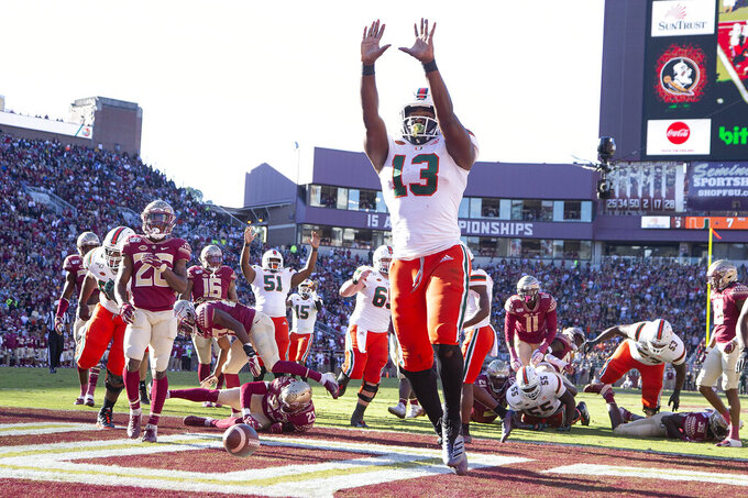 Miami running back DeeJay Dallas (13) celebrates his score against Florida State in the first half of an NCAA college football game in Tallahassee, Fla., Saturday, Nov. 2, 2019. (AP Photo/Mark Wallheiser)