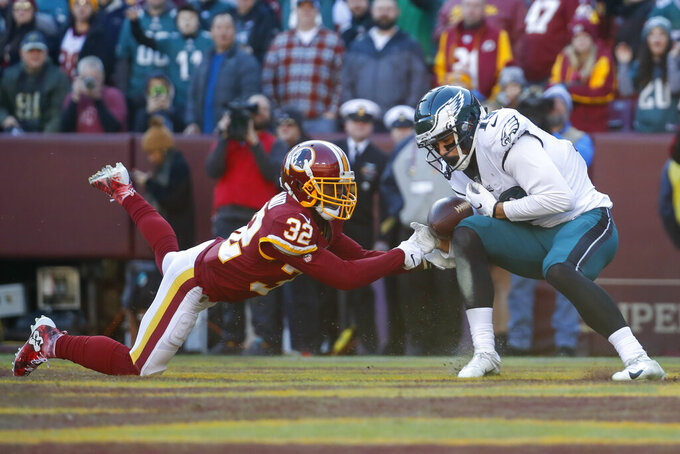 Washington Redskins cornerback Jimmy Moreland (32) breaks up pass intended for Philadelphia Eagles wide receiver J.J. Arcega-Whiteside (19) in the first half of an NFL football game, Sunday, Dec. 15, 2019, in Landover, Md. (AP Photo/Alex Brandon)