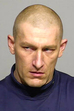 This undated photo provided by the Milwaukee County Sheriff's Office shows Geoffrey Graff, who was arrested Wednesday,  Nov. 20, 2019, after sheriff's deputies found an underground bunker and a stash of weapons in a secluded, wooded area along a river in Milwaukee. Officers found the bunker after residents reported shots fired. The sheriff says Graff admitted firing three shots into the river because he was angry at his dogs for running away.  (Milwaukee County Sheriff's Office via AP)