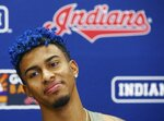 Cleveland Indians' Francisco Lindor pauses as he listens to a question as he talks about his injury and his rehab workouts at a news conference at the teams spring training baseball facility Monday, Feb. 18, 2019, in Goodyear, Ariz. (AP Photo/Ross D. Franklin)
