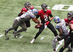 Detroit Lions defensive end Romeo Okwara, bottom left, gets past Atlanta Falcons tackle Jake Matthews, top left, to strip sack Falcons quarterback Matt Ryan (2) during the fourth quarter of an NFL football game Sunday, Oct. 25, 2020, in Atlanta. The Lions recovered the ball. (Curtis Compton/Atlanta Journal-Constitution via AP)