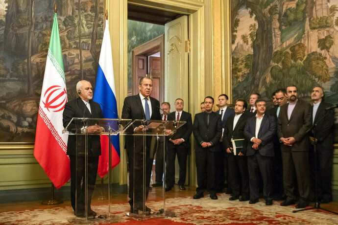 Russian Foreign Minister Sergey Lavrov and Iranian Foreign Minister Mohammad Javad Zarif, left, attend a news conference during their meeting in Moscow, Russia, Wednesday, May 8, 2019. (AP Photo/Pavel Golovkin)