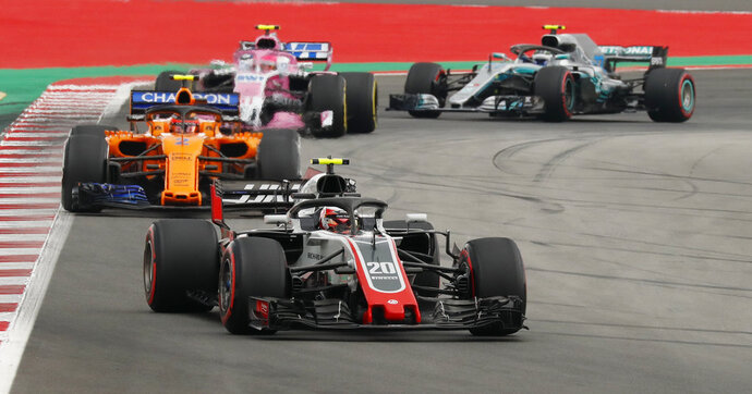 Haas driver Kevin Magnussen of Denmark leads Mclaren driver Stoffel Vandoorne of Belgium, Force India driver Esteban Ocon of France and Mercedes driver Valtteri Bottas of Finland during the qualifying session for the Spanish Formula One Grand Prix at the Barcelona Catalunya racetrack in Montmelo, Spain, Saturday, May 12, 2018. The Spanish Formula One Grand Prix will take place on Sunday. (AP Photo/Manu Fernandez)