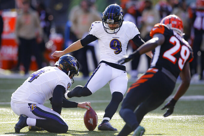 Baltimore Ravens kicker Justin Tucker (9) kicks an extra point during the first half of NFL football game against the Cincinnati Bengals, Sunday, Nov. 10, 2019, in Cincinnati. (AP Photo/Gary Landers)