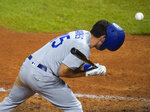 Los Angeles Dodgers' Austin Barnes loses his batting helmet after being clunked on the upper back by a pitch from Colorado Rockies' Ryan Castellani during the fifth inning of a baseball game Friday, Sept. 18, 2020, in Denver. (AP Photo/David Zalubowski)