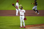 Cincinnati Reds relief pitcher Amir Garrett (50) tips his cap in the direction of the Pittsburgh Pirates' dugout after the Reds defeated the Pirates 4-1 in a baseball game in Cincinnati, Tuesday, Sept. 15, 2020. (AP Photo/Bryan Woolston)