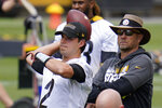 Pittsburgh Steelers quarterback Mason Rudolph (2) throws a pass under the watchful eye of offensive coordinator Matt Canada, right, during the team's NFL mini-camp football practice in Pittsburgh, Tuesday, June 15, 2021. (AP Photo/Gene J. Puskar)