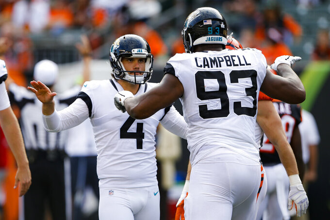 Jacksonville Jaguars kicker Josh Lambo (4) celebrates his field goal in the second half of an NFL football game against the Cincinnati Bengals, Sunday, Oct. 20, 2019, in Cincinnati. (AP Photo/Gary Landers)