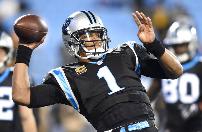 FILE - In this Monday, Dec. 17, 2018 file photo, Carolina Panthers' Cam Newton (1) warms up before an NFL football game against the New Orleans Saints in Charlotte, N.C. Panthers quarterback Cam Newton has had arthroscopic surgery on his right throwing shoulder. The team announced the surgery on Thursday, Jan. 24, 2019 saying Newton's rehabilitation process will begin immediately. (AP Photo/Mike McCarn, File)