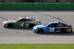 Kevin Harvick (4) and Martin Truex Jr. (19) run during a NASCAR Cup Series auto race Sunday, July 12, 2020, in Sparta, Ky. (AP Photo/Mark Humphrey)