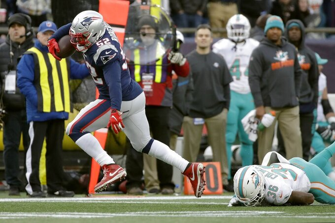 New England Patriots' Elandon Roberts runs away from Miami Dolphins safety Adrian Colbert, right, on his way to a touchdown after catching a pass in the second half of an NFL football game, Sunday, Dec. 29, 2019, in Foxborough, Mass. (AP Photo/Elise Amendola)