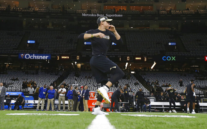 New Orleans Saints' Drew Brees warms up before the NFL football NFC championship game against the Los Angeles Rams Sunday, Jan. 20, 2019, in New Orleans. (AP Photo/Gerald Herbert)