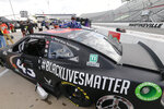 The car for driver Bubba Wallace has a Black Lives Matter logo as it is prepared for a NASCAR Cup Series auto race Wednesday, June 10, 2020, in Martinsville, Va. (AP Photo/Steve Helber)