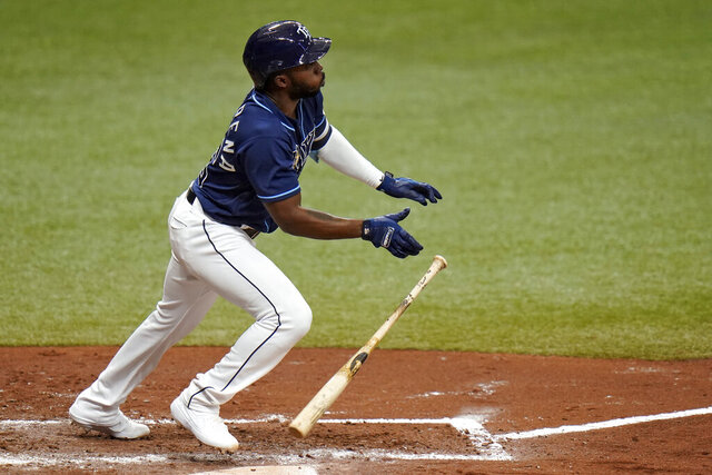 Tampa Bay Rays' Randy Arozarena hits a triple off Toronto Blue Jays pitcher Robbie Ray during the fourth inning of Game 1 of a wild card series playoff baseball game Tuesday, Sept. 29, 2020, in St. Petersburg, Fla. (AP Photo/Chris O'Meara)