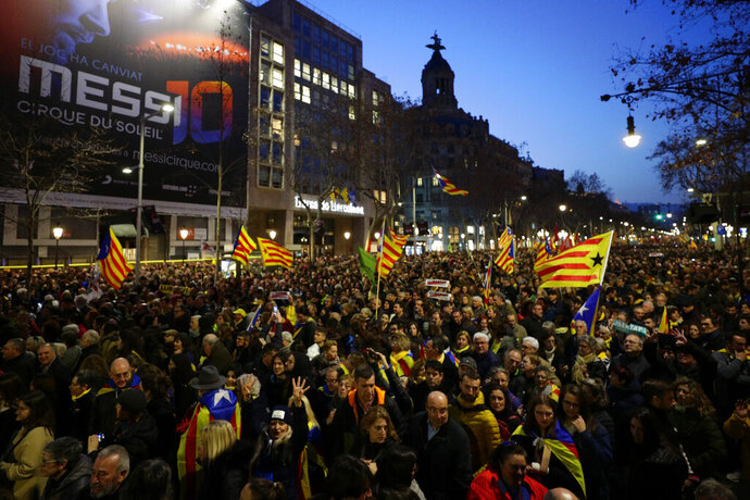 Demonstrators march along the street, during a protest in Barcelona, Spain, Thursday, Feb. 21, 2019. Protesters backing Catalonia's secession from Spain clashed with police and blocked major roads and train tracks across the northeastern region on Thursday during a strike called to protest the trial of a dozen separatist leaders. (AP Photo/Manu Fernandez)