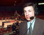 """FILE - Marv Albert poses at Madison Square Garden in New York, in this Sunday, Feb. 7, 1999, file photo, where he broadcast the Knicks season home opener against the Miami Heat for WFAN radio. Marv Albert plans to retire following the NBA's Eastern Conference finals, ending a broadcasting career that has spanned nearly 60 years. """"There is no voice more closely associated with NBA basketball than Marv Albert's,"""" NBA Commissioner Adam Silver said in a statement released Monday, May 17, 2021, by Turner Sports.(AP Photo/Ron Frehm, File)"""