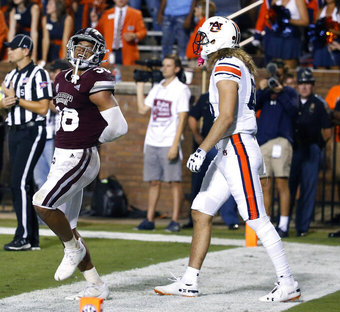 Mississippi State safety Johnathan Abram (38) taunts Auburn tight end Sal Cannella (80) after breaking up a pass during the second half of their NCAA college football game in Starkville, Miss., Saturday, Oct. 6, 2018. Mississippi State won 23-9. (AP Photo/Rogelio V. Solis)