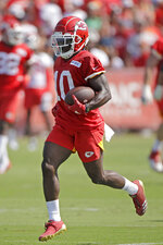 Kansas City Chiefs wide receiver Tyreek Hill runs the ball during NFL football training camp Saturday, July 27, 2019, in St. Joseph, Mo. (AP Photo/Charlie Riedel)