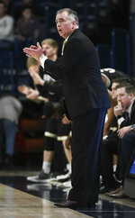 Wofford head coach Mike Young cheers on the team from the sidelines during the first half of an NCAA college basketball game against Samford Saturday, March 2, 2019, in Birmingham, Ala. (AP Photo/Julie Bennett)