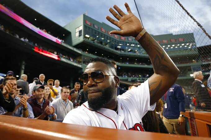 Former Boston Red Sox's David Ortiz waves to the crowd after throwing out a ceremonial first pitch before a baseball game against the New York Yankees in Boston, Sept. 9, 2019. (AP Photo/Michael Dwyer)