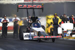 In this photo provided by the NHRA, Steve Torrence drives in Top Fuel qualifying at the Lucas Oil NHRA Winternationals drag races at Auto Club Raceway at Pomona, Calif., Friday, Feb. 8, 2019. Torrence leads the Top Fuel category with a run of 3.716-seconds at 330.07 mph. (Marc Gewertz/NHRA via AP)