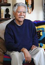 FILE - In this April 28, 2011, file photo, author Rudolfo Anaya poses for a photo at home in Albuquerque, N.M. Anaya, 82, who helped launch the 1970s Chicano Literature Movement with his novel