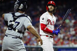 Philadelphia Phillies' Bryce Harper, right, looks up after striking out during the eighth inning of a baseball game against the San Diego Padres, Saturday, Aug. 17, 2019, in Philadelphia. (AP Photo/Matt Rourke)
