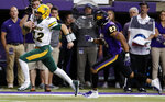 FILE - In this Saturday, Oct. 6, 2018, file photo, North Dakota State quarterback Easton Stick (12) runs from Northern Iowa defensive back A.J. Allen (23) during a 31-yard touchdown run in the second half of an NCAA college football game, in Cedar Falls, Iowa. North Dakota State begins its hunt for its seventh Football Championship Subdivision title in eight years with a familiar ingredient on offense: a high-quality quarterback with plenty of experience in senior Stick. (AP Photo/Charlie Neibergall, File)