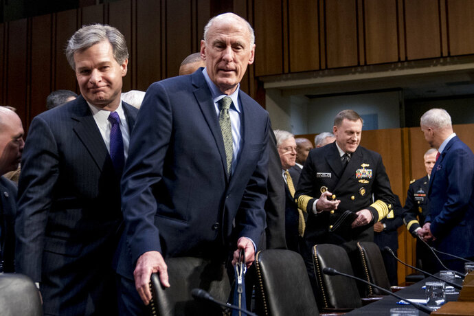 FBI Director Christopher Wray, left, and Director of National Intelligence Dan Coats, second from left, arrive for a Senate Select Committee on Intelligence hearing on worldwide threats, Tuesday, Feb. 13, 2018, in Washington. (AP Photo/Andrew Harnik)