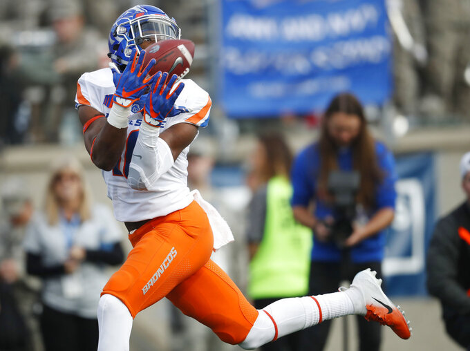 Boise State wide receiver John Hightower pulls in a pass for a touchdown against Air Force in the first half of an NCAA college football game Saturday, Oct. 27, 2018, at Air Force Academy, Colo. (AP Photo/David Zalubowski)