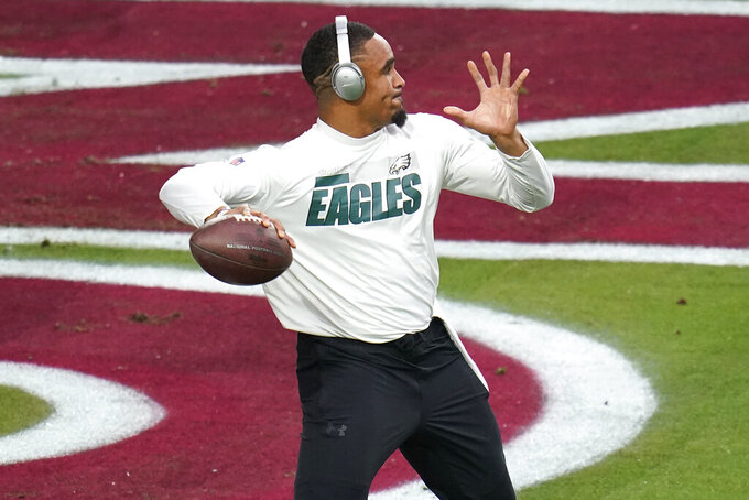 Philadelphia Eagles quarterback Jalen Hurts warms up prior to an NFL football game against the Arizona Cardinals, Sunday, Dec. 20, 2020, in Glendale, Ariz. (AP Photo/Ross D. Franklin)