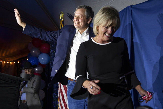Sen. Steve Daines, R-Mont., prepares to speak to supporters with his wife Cindy during his election watch party in Bozeman, Mont., Tuesday,  Nov. 3, 2020. (AP Photo/Tommy Martino)