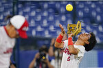 Japan's Yu Yamamoto catches a fly out during a softball game against the United States at the 2020 Summer Olympics, Tuesday, July 27, 2021, in Yokohama, Japan. (AP Photo/Sue Ogrocki)