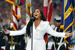 FILE - In this Feb. 2, 2020, file photo, Demi Lovato performs the national anthem before the NFL Super Bowl 54 football game in Miami Gardens, Fla. Bubba Wallace now counts Spike Lee and Demi Lovato – his admitted celebrity crush – as those loudly in his corner since he's become the leader of NASCAR's push for change. (AP Photo/David J. Phillip, File)
