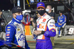 Ricky Stenhouse Jr., left, and Denny Hamlin talks on pit road before the first of two qualifying NASCAR auto races for the Daytona 500 at Daytona International Speedway, Thursday, Feb. 11, 2021, in Daytona Beach, Fla. (AP Photo/John Raoux)
