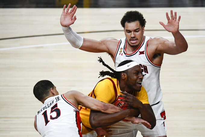 Iowa State's Solomon Young (33) is fouled by Texas Tech's Kevin McCullar (15) during the second half of an NCAA college basketball game in Lubbock, Texas, Thursday, March 4, 2021. (AP Photo/Justin Rex)