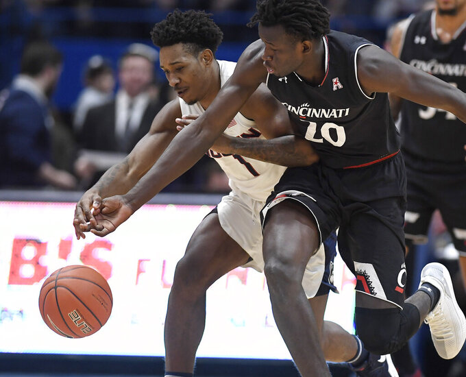 Connecticut's Christian Vital (1) tangles with Cincinnati's Mamoudou Diarra (20) during the first half of an NCAA college basketball game, Sunday, Feb. 24, 2019, in Hartford, Conn. (AP Photo/Jessica Hill)