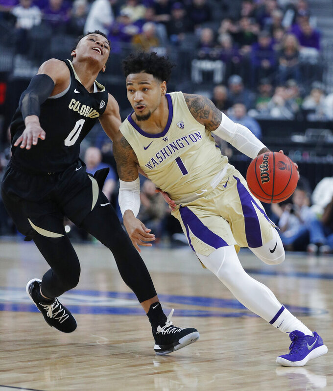 Washington's David Crisp drives around Colorado's Shane Gatling during the second half of an NCAA college basketball game in the semifinals of the Pac-12 men's tournament Friday, March 15, 2019, in Las Vegas. (AP Photo/John Locher)