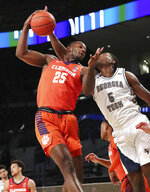 Clemson forward Aamir Simms grabs a rebound next to Georgia Tech forward Moses Wright during the first half of an NCAA college basketball game Wednesday, Jan. 20, 2021, in Atlanta. (Curtis Compton/Atlanta Journal Constitution via AP, Pool)